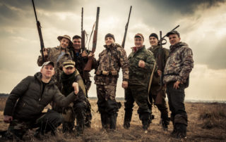Group of men enjoying their exotic hunting experience at the Austin Trophy Whitetails hunting ranch.